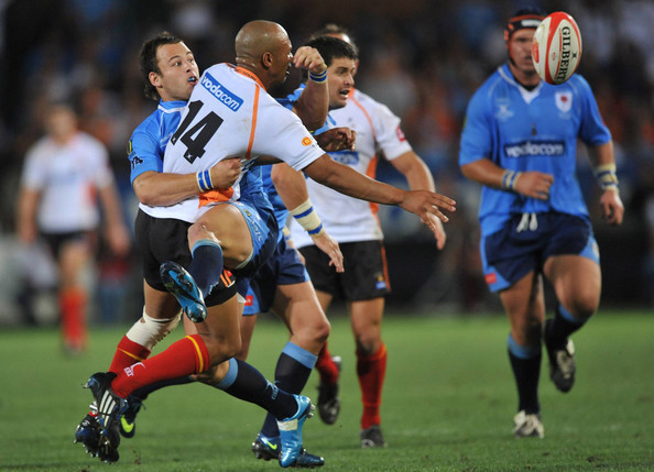 Lionel Mapoe of the Cheetahs tackled by Francois Hougaard of the Bulls during the Absa Currie Cup match between Blue Bulls and Free State Cheetahs from Loftus Versfeld on October 31, 2009 in Pretoria, South Africa. (October 30, 2009 - Photo by Gallo Images/Getty Images Europe)