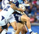 Blues winger Rene Ranger trying to evade the defence of the DHL Stormers'  Peter Grant