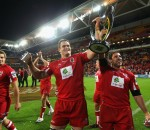 Reds captain James Horwill and team mate Ben Daley celebrate with the trophy after winning the 2011 Super Rugby Grand Final match between the Reds and the Crusaders at Suncorp Stadium on July 9, 2011 in Brisbane, Australia. Photo by Cameron Spencer /Getty Images.