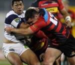 Charles Piutau of Auckland is tackled by Ryan Crotty of Canterbury during the 2010 ITM Cup. Photo by Getty Images.