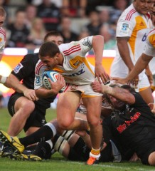 Tawera Kerr-Barlow attempting to break through the Sharks defense in Durban. Photo by Getty Images.