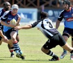 Juan Language of KZN champions Jonsson College Rovers gets past the tackle of Ryan Pietersen of Border champions Broubart Old Selbornians in the first semi-final of the SARU National Club Championships at the Impala Rugby Club in Rustenburg on Wednesday.