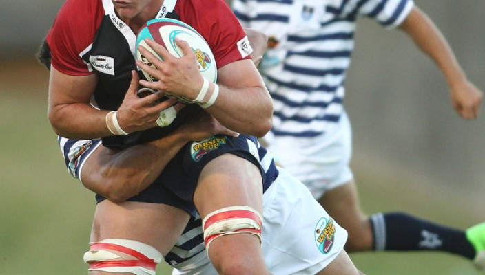 NMMU lock Louis Johannes Fourie gets tackled from behind during the 2013 Varsity Cup match between FNB UCT and FNB NMMU from UCT Rugby Fields on February 04, 2013 in Cape Town, South Africa. Photo by Shaun Roy / Gallo Images