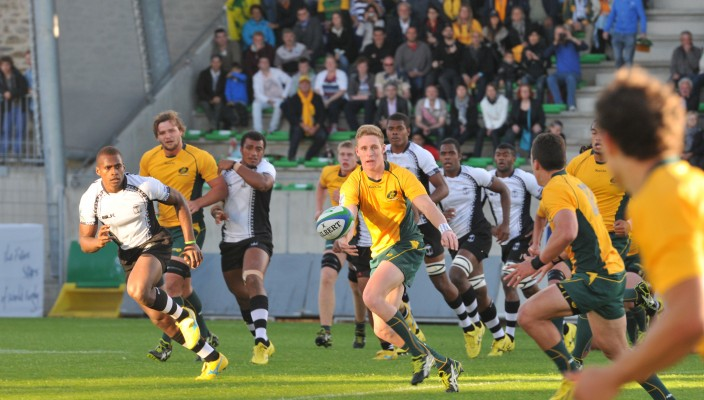IRB JWC 2013 Pool B- Australia v Fiji Australia launch an attack against Fiji in the final game of Pool B in Vannes. by Michel Renac