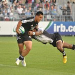 Pool B- New Zealand v Fiji A Kiwi tries to break a Fijian tackle in the Pool B match in Vannes. Photo- Michel Renac