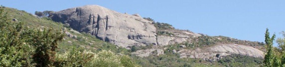 'Neath the far famed rock of granite grey......