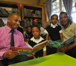 Wayne Julies and Desmond Ceasar: Former Springbok centre and South African Rugby Legends Association Member, Wayne Julies (right) with the Principal, Mr Desmond Ceasar, and learners at the Groenheuwel Primary School in Paarl in the Western Cape in a new library provided by the South African Rugby Union as part of their Boks for Books CSI initiative. Springbok Women's player Denita Wentzel is reading in the background.