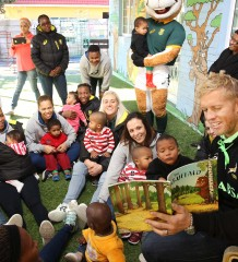 CAPE TOWN, SOUTH AFRICA - JULY 18: Kyle Brownreads to the kids during the Springbok Sevens 67 minutes on Nelson Mandela Day at Christine Revell Children's Home and Lagunya Rugby Club on July 18, 2015 in Cape Town, South Africa. (Photo by Luke Walker/Gallo Images)