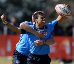 Embrose Papier of Blue Bulls celebrates his winning try at the 2013 Coca-Cola grant Khomo Week