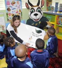 STELLENBOSCH, SOUTH AFRICA - AUGUST 27: General view of Denita Wentzel (Womens Springbok player) reading too the children during the Boks for Books library handover at JJ Rhode Primary School on August 27, 2015 in Stellenbosch, South Africa. (Photo by Ashley Vlotman/Gallo Images)