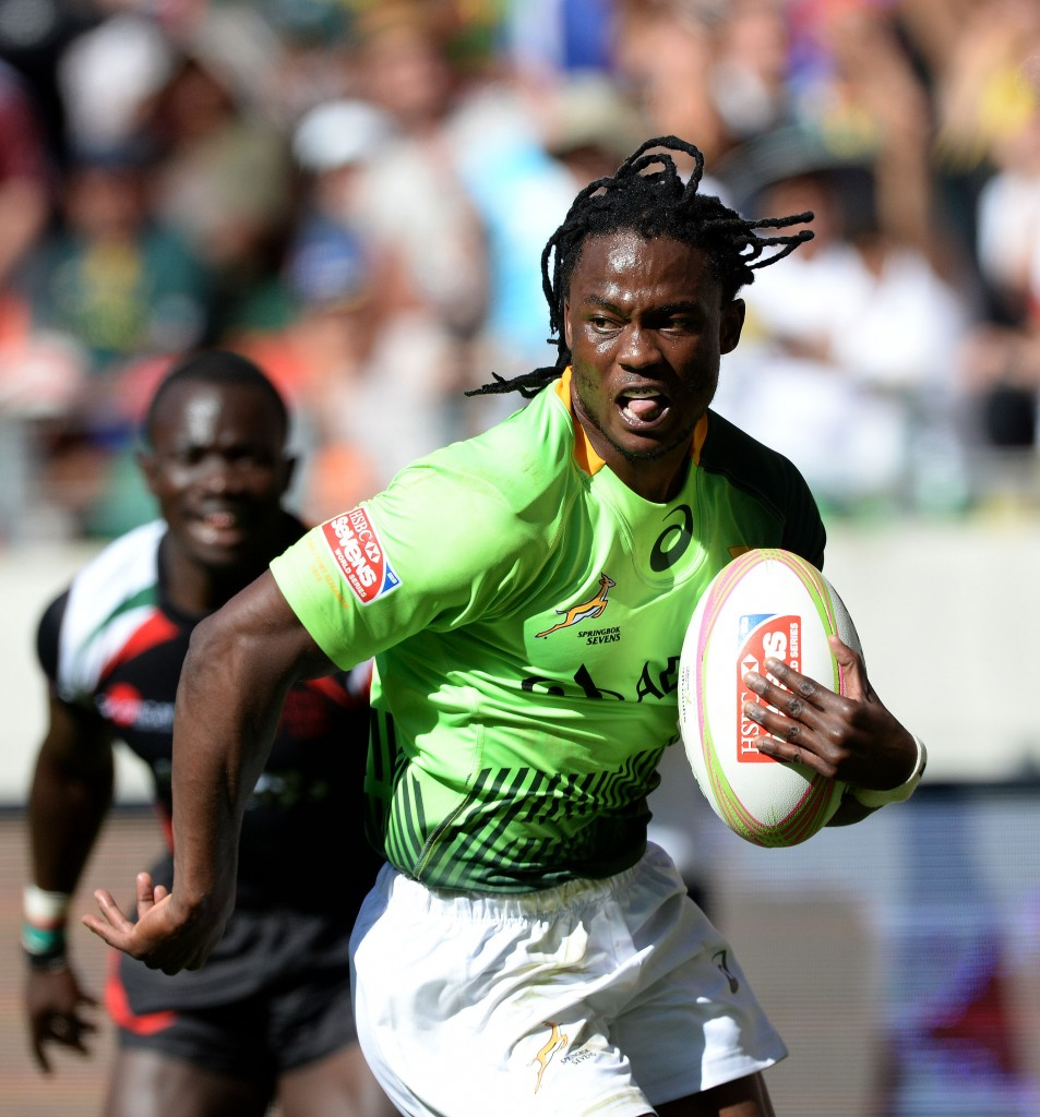 PORT ELIZABETH, SOUTH AFRICA - DECEMBER 13: Seabelo Senatla of South Africa runs in for his second try during day 1 of the Cell C Nelson Mandela Bay Sevens Series at Nelson Mandela Bay Stadium on December 13, 2014 in Port Elizabeth, South Africa. (Photo by Duif du Toit/Gallo images)