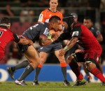 St.George Queensland Reds v Crusaders pre-season match - Reds centre Duncan Paia'aua carries the ball into contact.