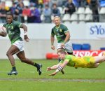 PARIS, FRANCE - MAY 14: Seabelo Senatla of South Africa evades a flying Australian during the match between South Africa and Australia on day 2 of the HSBC World Rugby Sevens France at Stade Jean Bouin on May 14, 2016 in Paris, France. (Photo by Roger Sedres/Gallo Images)