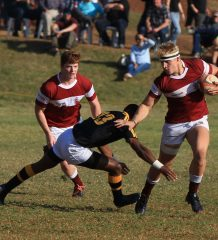 Rugby - Kearsney man of the match Dylan Richardson fends off St Charles