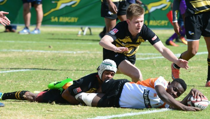 JOHANNESBURG, SOUTH AFRICA - JULY 17: Romeo Eksteen of Boland can't stop Teboho Rampai of Free State from scoring during the match between Free State and Boland on day 1 of the 2017 U/18 Coca-Cola Craven Week at St Stithians College on July 17, 2017 in Johannesburg, South Africa. (Photo by Lee Warren/Gallo Images)