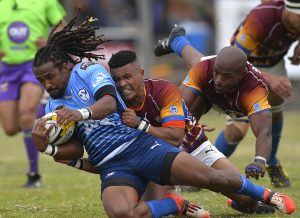 CAPE TOWN, SOUTH AFRICA - OCTOBER 14: Tythan-Franco Adams of College Rovers tackled by Tyron Scholtz of Tygerberg during the Gold Cup quarter final match between Tygerberg and Go Nutz College Rovers at Florida Park on October 14, 2017 in Cape Town, South Africa. (Photo by Ashley Vlotman/Gallo Images)